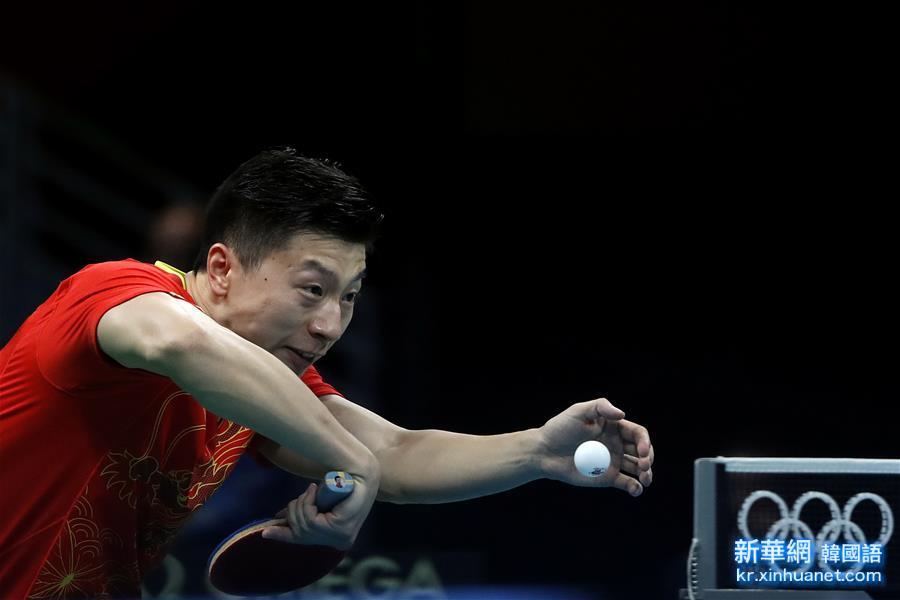 (裏約奧運會)(1)乒乓球——中國選手馬龍成功晉級