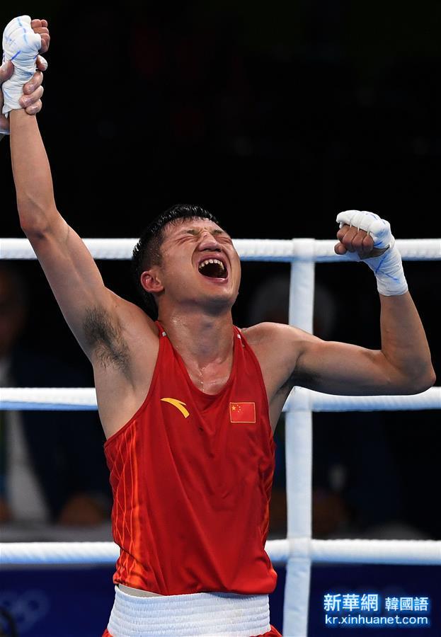 (裏約奧運會)(1)拳擊——男子56公斤級預賽:中國選手張家瑋獲勝