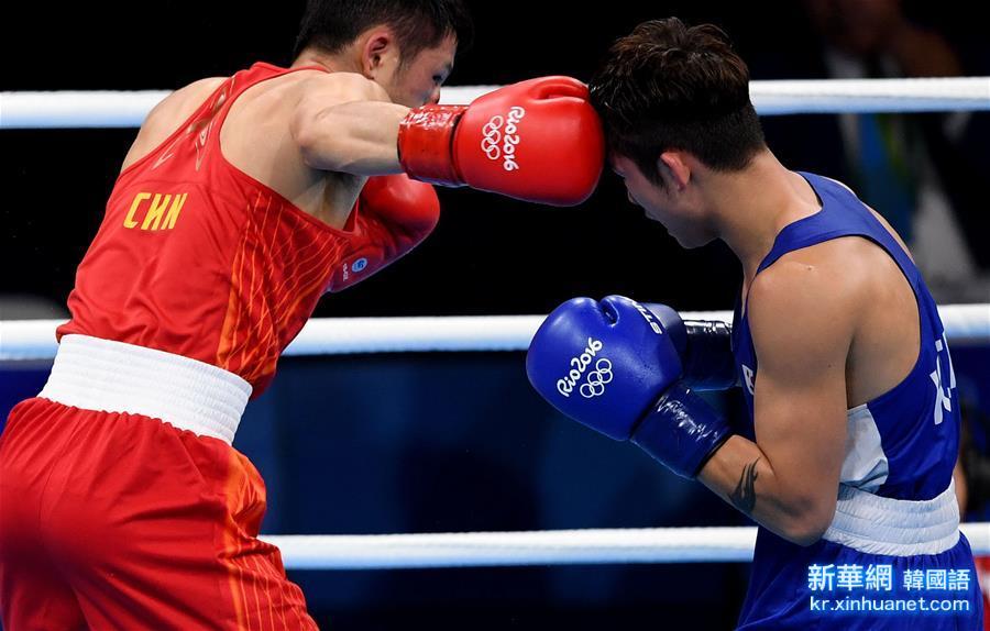 (裏約奧運會)(3)拳擊——男子56公斤級預賽:中國選手張家瑋獲勝