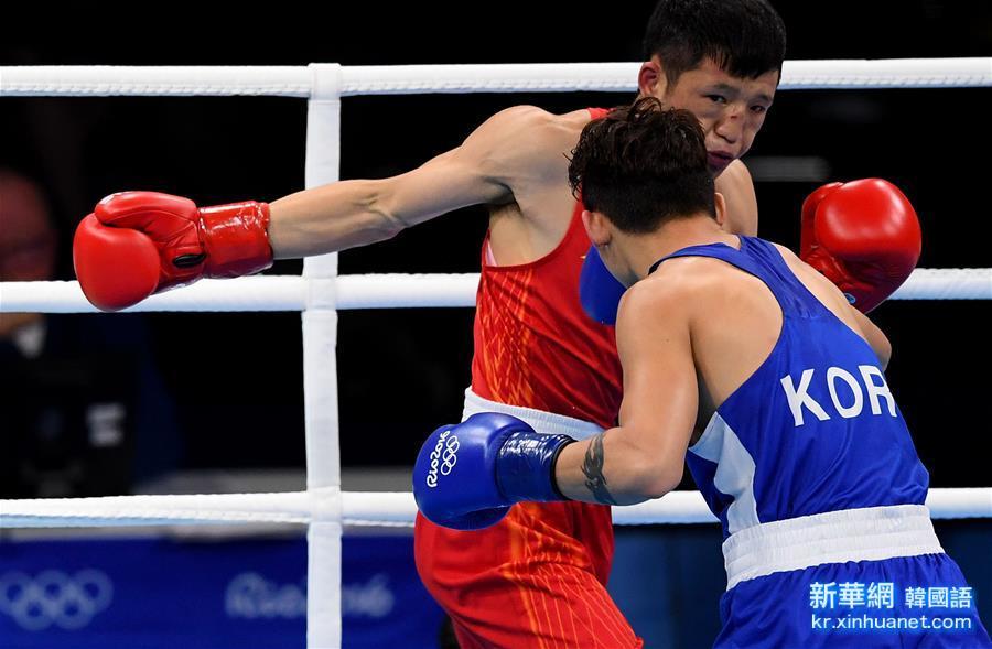(裏約奧運會)(7)拳擊——男子56公斤級預賽:中國選手張家瑋獲勝