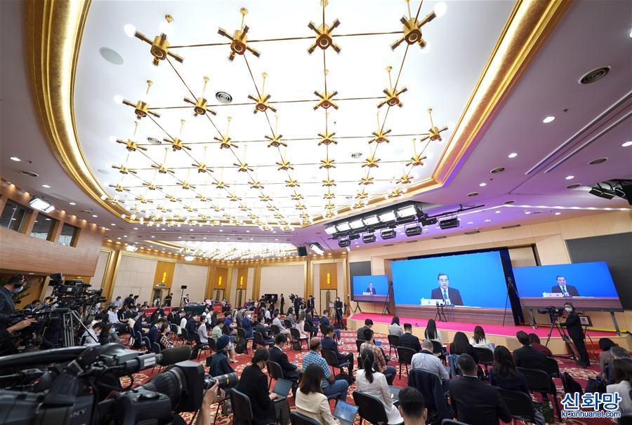 (兩會·XHDW)(16)國務委員兼外交部長王毅回答中外記者提問
