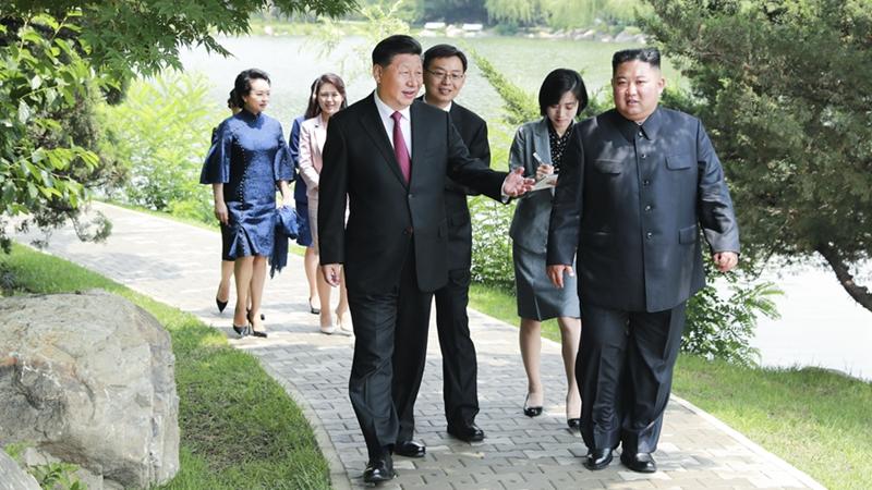 시진핑, 김정은 조선로동당 위원장, 국무위원회 위원장 회견