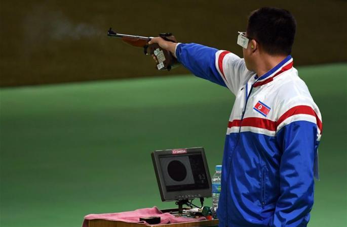 朝 김성국, 사격 남자 50m 권총 동메달